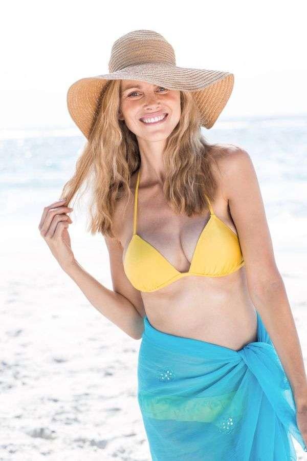 Smiling pretty blonde in bikini looking at camera at the beach, Image: 244452130, License: Royalty-free, Restrictions: , Model Release: yes, Credit line: Profimedia, Wavebreak